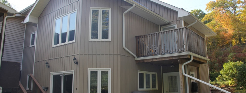Residential - grey house with vertical siding - rear view