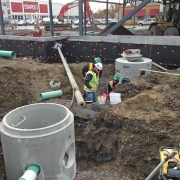Commercial project - 2140 Carling Rd. - storm water service pump tank, foundation water proofing, trenching, excavation, site service, building service connection