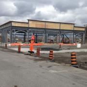 Commercial project 2140 Carling Rd. - site work, steel framing, parking lot, concrete sidewalk, building frame, no sheathing