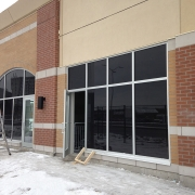 Commercial project - 2140 Carling Rd. - stucco masonry veneer - aluminum storefront glazing, exterior lighting, concrete banding, exterior with windows