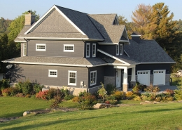 Residential project - blue house with white trim - front view