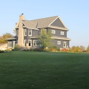Residential project - blue house with white trim - panorama