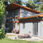 Residential project - grey and orange cottage - back patio