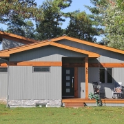 Residential project - grey and orange cottage - entrance