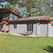 Residential project - grey and orange cottage - rear patio
