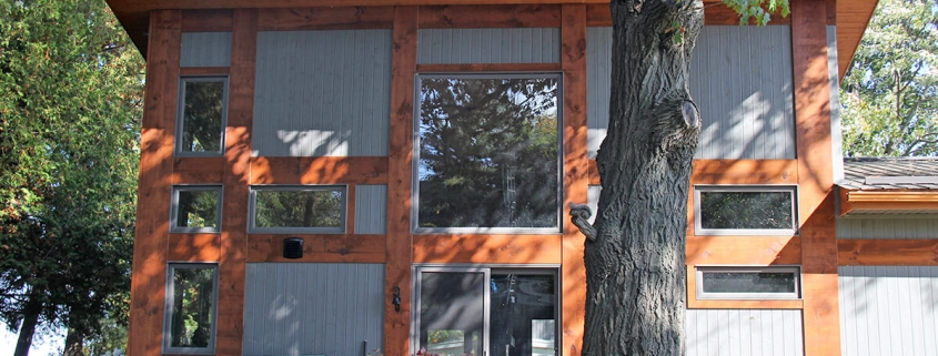 Residential project - grey and orange cottage - rear view, two storey