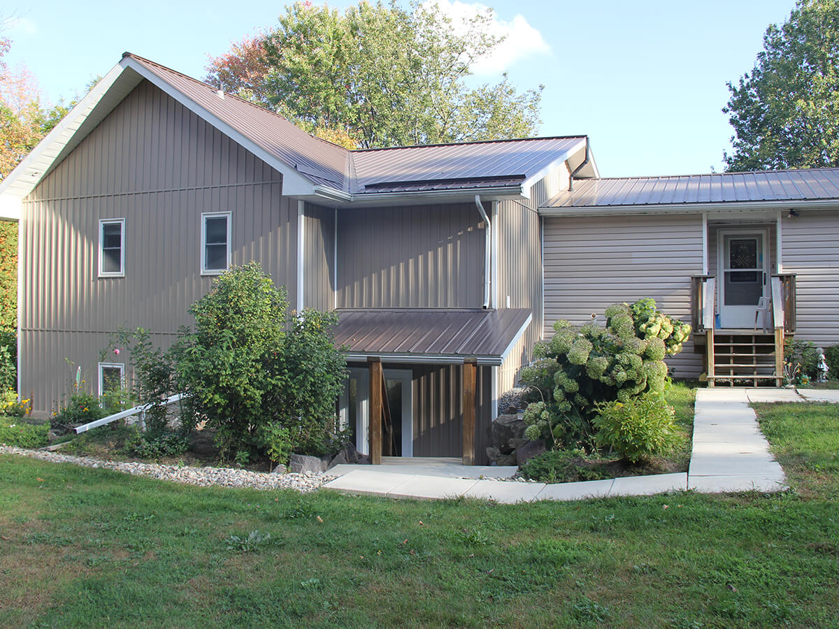 Residential projects grey house with vertical siding r for Vertical house siding