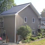 Residential project - grey house with veritcal sidding - left front view