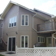 Residential project - grey house with veritcal sidding - left side view