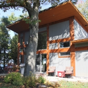 Residential project - grey and orange cottage - rear view