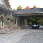 Residential project - green stone house with horizontal siding - breezeway porch