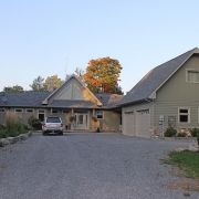 Residential project - green stone house with horizontal siding - entrance